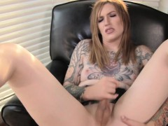 Tattooed Tranny Tugging On Her Dick
