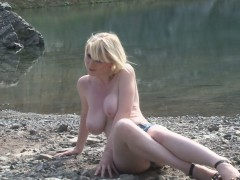 hot-blonde-with-big-tits-enjoys-the-lake