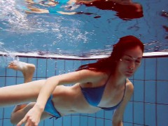 Redhead In Blue Bikini Showing Her Body