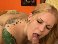chubby-tattooed-chick-sucking-a-cock
