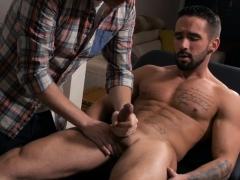 A Masseur Strokes Client's Stiff Penis