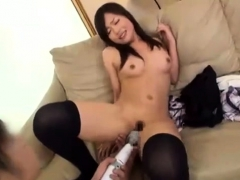 hot-brunette-in-stockings-fingering-and-toying-pussy