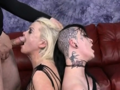 tattooed up whores on the floor gagging on two guys dicks