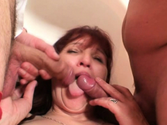 old mature slut swallows two cocks at once