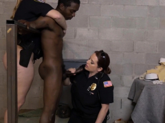 Two female police officers take a black guy to jail.