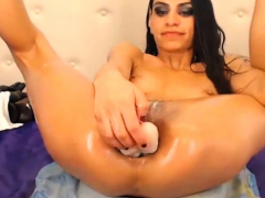 Skinny Bitch likes to get a large rubber penis in the ass
