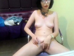 sylvia-saint-on-small-chair-with-ally-fingering