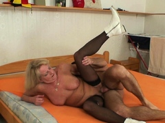 blonde-70-years-old-grandma-in-black-stockings