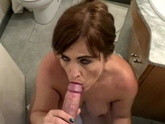 sexy cougar blowing the studs dick in the bathroom