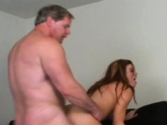 alluring-woman-blowing-large-fuck-stick
