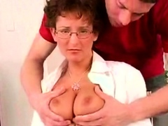 Slender mature beauty with massive natural tits is fingered