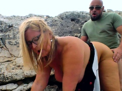 fatty-mature-lady-taking-cock-on-the-rocks