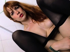 Redhead in pantyhose takes a shower