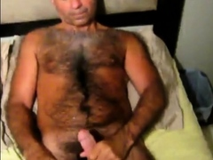 Very hairy daddy strokling his cock