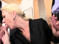 Old mature blonde swallows two cocks for job