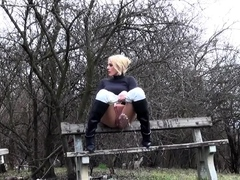 Blonde Enjoys A Messy Piss Outside