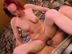redhead-milf-sucking-cock-on-her-knees